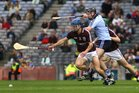 <br /> Galway's, Billy Lane and Gerard O'Donoghue,<br /> and<br /> Dublin's, Sean McClelland,<br /> during the All-Ireland Minor Hurling Championship Final.<br />