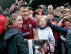 Galway captain Damien Comer with young supporters after the game.