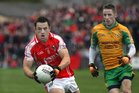 <br /> Corofin's,  Michael Lundy,<br /> and<br /> Tuam Stars, Jamie Murphy,<br /> during the County Senior Football Championship Final<br /> at Tuam Stadium.<br />