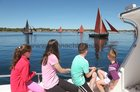 Young spectators watch the traditional sail boats taking part in Feile an Spideal last Sunday.