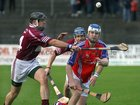 <br />  Clarinbridge's, Eoin Forde and Shane Burke,<br />  and<br />  St. Thomas, Robert Murray,<br />  during the Senior Hurling Championship at Athenry.<br />