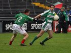 <br /> Oughterard's, Matthew Clancy,<br />  and<br />  Kilconly's, Mike Newell,<br />  during the County Intermediate Football Championship Final  at Pearse Stadium.
