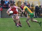 <br /> Corofin's, Damien Burke,<br /> and<br /> Tuam Stars, Tony Costello,<br /> during the County Senior Football Championship Final<br /> at Tuan Stadium.<br />