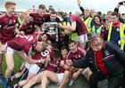 Galway players celebrate after defeating Roscommon to win the Connacht Senior Football final at Dr Hyde Park in Roscommon.