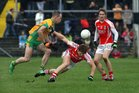 <br /> Corofin's, Damien Burke,<br /> and<br /> Tuam Stars, Tony Costello,<br /> during the County Senior Football Championship Final<br /> at Tuam Stadium.<br />