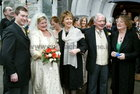 The President, Mary McAleese, with newely married Philip Carney and Crona Byrne, and the brides parents, Gay Byrne and Kathleen Watkins, at Spiddal Church.  28 September 2004