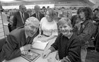 Gay Byrne meeting with a young fan while signing copies of his book 'The Time of My Life' in the Eason Bookshop in Shop Street in October 1989.
