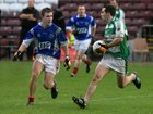 Kilconly's, Adrian Murphy,<br /> and<br /> Oughterard's, Eddie O'Sullivan,<br /> during the Intermediate Football Championship Final<br /> Replay at Pearse Stadium.<br />