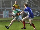 <br /> Kilconly's, David Glynn,<br /> and<br /> Oughterard's, Mark McGauley,<br /> during the Intermediate Football Championship Final<br /> Replay at Pearse Stadium.<br />