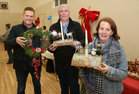 Cllr Alan Cheevers, Donal Lynch and Mary Larkin at the Ballybane Christmas Fair in the Ballybane Community Centre last Saturday. They are holding some of the Christmas crafts made by members of the Mens Shed in aid of the Patients Comfort Fund at Merlin Park Hospital.