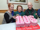 Bridie Daly, with her daughter Maryanne Volk and her husband Bill Volk, as she cuts her 106th birthday cake in O'Meara's, Portumna