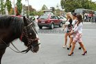 BEST FOOT FORWARD . . . race goers at Eyre Square yesterday on their way to Ladies Day at the Galway Races.