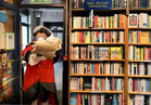 Galway Town Crier Liam Silke at the door of Charlie Byrne's Bookshop on Middle Street while he was out on the city centre streets on Monday welcoming back shoppers and thanking staff and business owners, who have been able to reopen, after the easing of Covid-19 restrictions.