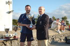 Pictured at the finals of Tag Rugby 2011 at Corinthian Park on Friday 22 July<br /> <br /> John Colleran, President of Galway Corinthians presemts the B Grade Cup to James Taylor of HP Saucier.