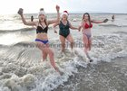 Katie Killarney, her mother Helen Healy and her niece Anne O'Connor, Athenry, at Blackrock for their Christmas Day swim.