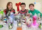 Martina McDonagh, Anne Finnerty and Margaret Corbett of St Michaels Boys School, Mervue, Parents Creativity Art Group at the display of some of the crafts and gifts during the Ballybane Christmas Fair in the Ballybane Community Centre last Saturday.