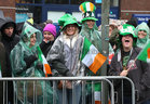 Happy faces as the rain falls down at the St Patrick's Day Parade in the city centre.