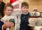 Khloe (6) and Leon (4) McDonagh from Ballybane with Santa at the Ballybane Christmas Fair in the Ballybane Community Centre last Saturday.