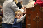 A young member of the congregation during the the annual Solemn Novena at Galway Cathedral this week.