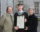Stephen McEnery from Claddagh with his parents Brian McEnery and Catherine Connolly TD after he was conferred with a B A Honours degree at NUI Galway.