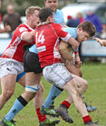Galwegians v Cashel Ulster Bank All Ireland League Division 2A game at Crowley Park.<br /> Michael O'Donnell, Galwegians, tackled by Richard Kingston and Frank Kelleher, Cashel