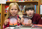 Aoife Harrison, Devon Park, and Molly O'Malley, Salthill, at the launch of Patricia Forde's new novel, 'Mother Tongue' in Charlie Byrne's Bookshop.