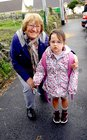 <br /> Cliona Ward, with her grandmother Patricia O'Connor, on her first Day at Menlo National School.