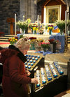 Lighting candles during the annual Solemn Novena to Our Lady of Perpetual Help at Galway Cathedral this week.