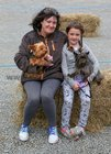 Maura Dillon and her daughter Stephanie Burke from Knocknacarra with Guinness and Tiny at the dog show during the annual Maam Cross Connemara Pony Show.