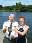 Paddy Cronin of Galway Rowing Club presenting Anna Pim of Lagan Scullers with her trophy after she won the Junior 14 Singles event at the Galway Regatta.