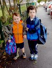 <br /> Aran McMenamon, with his brother Oran, on his first Day at Menlo National School.