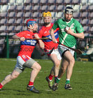 Abbeyknockmoy v Moycullen Senior Hurling B Group 2 game at the Pearse Stadium.<br /> Moycullen's Vincent Faherty and Abbeyknockmoy's Eoin Loftus and Danny Mullins