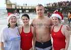 Maria Quinn  and her daughter Edel and Joe and Christina Hyland, Tuam Road, after their Christmas day swim for COPE Galway at Blackrock.