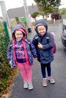 <br /> Makayla Fahy, with her sister Lauren, on her first Day at Menlo National School.