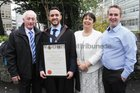 <br /> Sean O'Boyle, Cotofin, with his parents Sean and Rose, brother Alan, after he was conferred HRM Degree t NUIGalway.