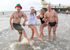 Kevin, Fiona and Jackie Barron, Knocknacarra, and Ivor Robinson of Ivor's Motorcycles after their Christmas Day Swim at Blackrock.