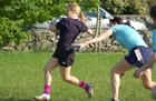 Action from week 2 of Tag Rugby at Galway Corinthians<br /> <br /> Ruth Devanny of Fidelity Flyers is tagged by Siobhan Quaid of Scrummy Dummies