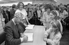 Gay Byrne meeting with young fans while signing copies of his book 'The Time of My Life' in the Eason Bookshop in Shop Street in October 1989.