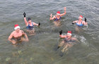 Helen McGourty, front, and from left: Kevin McGlade, Charlene Murphy, Nina McGlade and Jackie Browne from Kinvara and Galway after finishing their Christmas Day swim for Cope Galway at Blackrock.