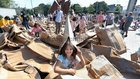 The People Build cardboard structure is trampled on for recycling after it was knocked down on Sunday.
