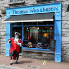 Galway Town Crier Liam Silke outside Thomas Woodberrys in Middle Street on Monday welcoming back shoppers and thanking staff and business owners who have been able to reopen after the easing of Covid-19 restrictions.