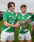 Séamus and Donal Mac an Choiligh celebrate after Moycullen won the Senior Football Championship final at Pearse Stadium.<br />