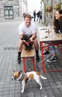 Kevin Mc Keague, Kiltormer, with his dogs Nell and Wilko, at the Market Day at the Spanish Arch