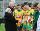 President Michael D Higgins is introduced to the corofin players by joint team captain Micheál Lundy before the start of the AIB GAA Football All-Ireland Senior Club Championship final at Croke Park.