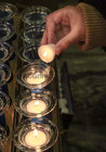 Lighting a candle at the annual Solemn Novena at Galway Cathedral