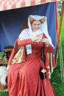 <br /> Helen Stackpoole, spinning wool  at the International Medieval Combat Tournament at Claregalway Castle.