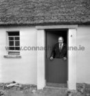 Paddy Cunnane, foreman, in one of the thatched cottages at Tullycross.<br /> The Tullycross thatched cottages under construction 15 March 1973