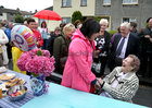Eileen Molloy meeing with neighbours and friends at her 100th birthday party in Davis Road.