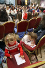 Children catch up on some drawing during Anthony Ryans Annual Communion Wear Fashion Show.
