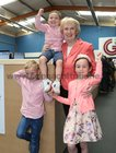 Cllr Terry O'Flaherty celebrates with her grandnephews Ruadhan  and Liam and grandniece Fainse Loughlin, after she was elected during the Galway City East count at the Westside centre.